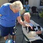 Seniors Playing with Goat at Lil Bit of Living Petting Zoo Senior Living The Cove at Tavares Village