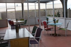 Patio outside of Memory Care at The Cove at Tavares Village in Tavares, FL