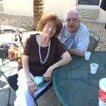 Senior Couple Enjoying the Outdoors Lil Bit of Living Petting Zoo Senior Living The Cove at Tavares Village