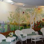 Assisted Living Facility Mural and Chairs at The Cove at Tavares Village in Tavares, FL