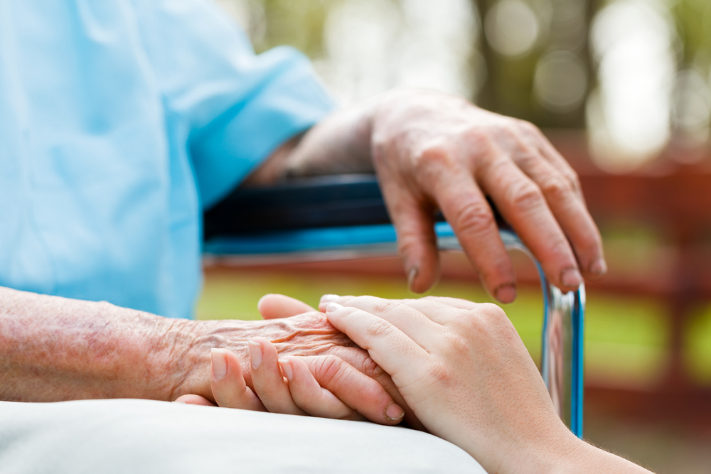 Assisted Living Facility Frequently Asked Questions Header Photo of Elderly Hands Being Held