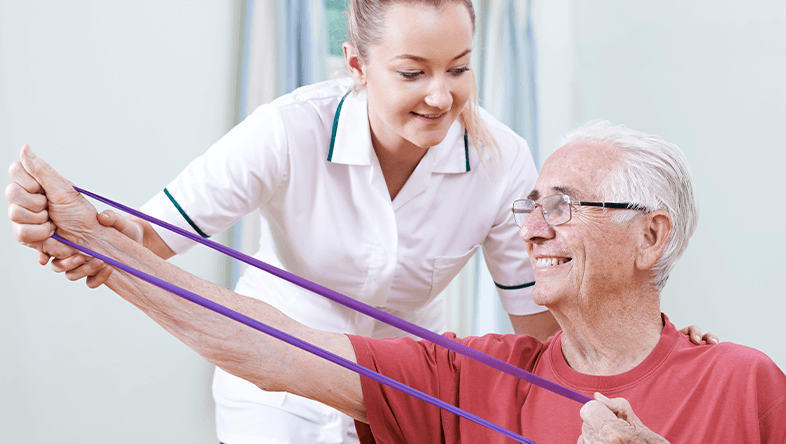 Physical Therapist working senior patient