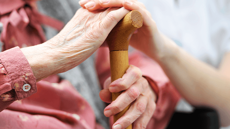 Caring for a Senior Holding Their Hand